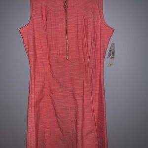 Light red colored dress. Sheath style